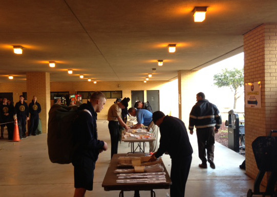 Bags Airline Check-In agents assisting US Servicemen and Servicewomen flying out of San Antonio for their holiday leave